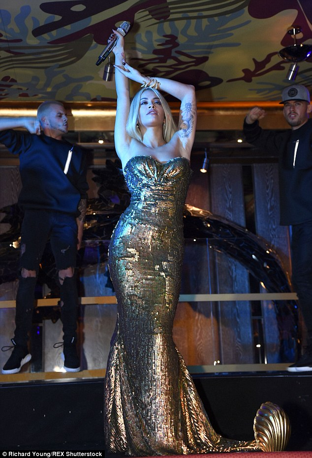 Sensational: The 24-year-old, who is an ambassador of the eatery, was turning heads in the floor-sweeping dress as she oozed Hollywood glamour for her performance at the star-studded event