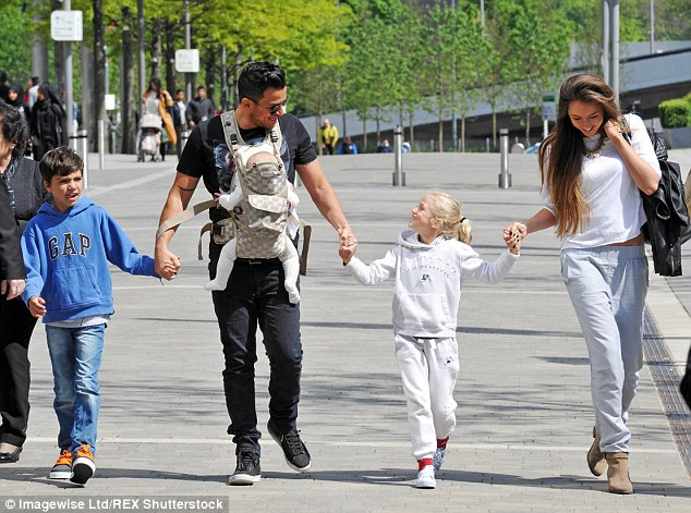 Dedicated father:  Peter has children Junior, 10, and Princess, eight, with ex-wife Katie Price, and one-year-old Amelia with new bride Emily MacDonagh, 23 (pictured)