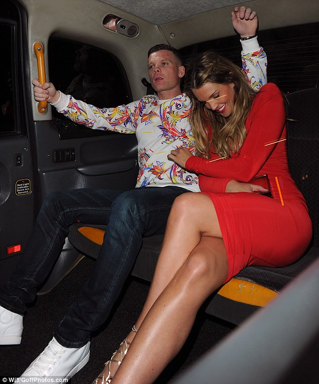 Full of giggles: The leggy blonde was all smiles as they cosied up together in the back of a cab
