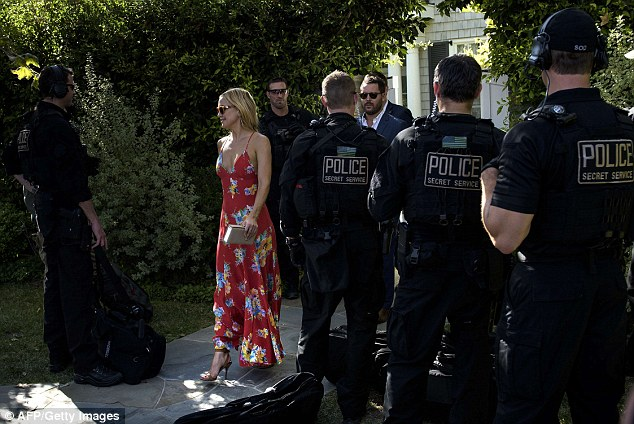 A busty display: Slipping into the flowing red maxi dress, the blonde bombshell flashed more than a hint of cleavage thanks to the garments plunging neckline