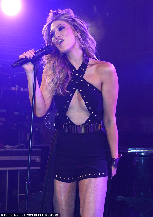 Storming the stage! Delta Goodrem, 30, donned a daring keyhole playsuit as she performed in London's G-A-Y nightclub on Saturday night