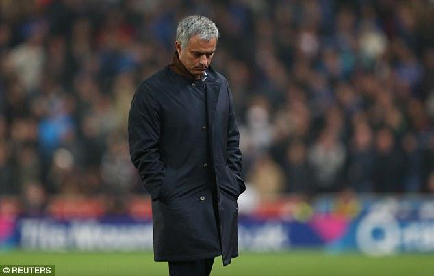Mourinho looks glum during his side's Capital One Cup clash against Stoke at the Britannia Stadium