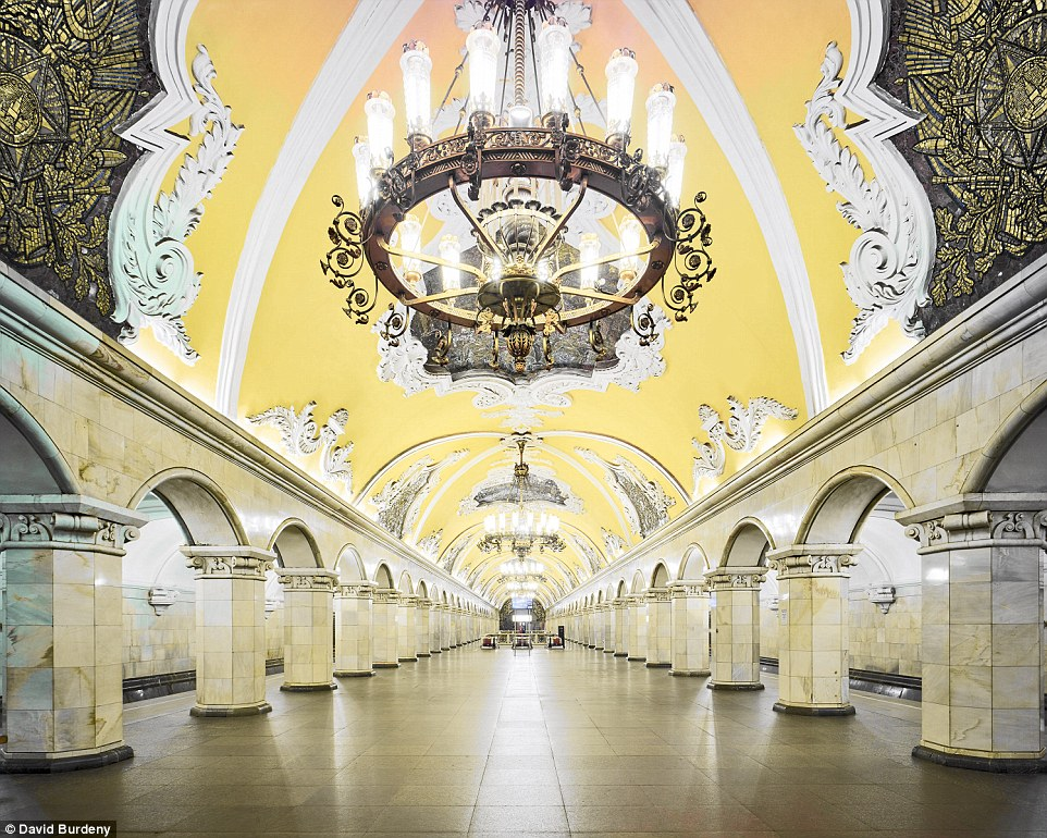 Guests waiting for trains at the yellow Komsomolskaya Metro Station are treated to yellow ceilings and magnificent chandeliers