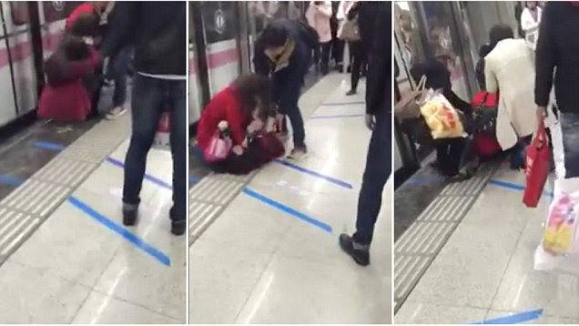 Two women PUNCH each other on video on subway platform in China