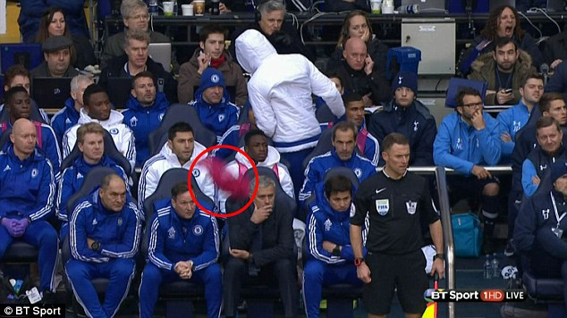 The bib sails behind Mourinho's right shoulder but the Chelsea boss seemed oblivious as it flew to the ground
