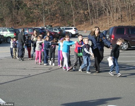 To illustrate his point, Chesley made a bizarre reference to the Sandy Hook massacre, suggesting it didn't take place as described in the official narrative. Above, children are led away from the December 2012 tragedy,  which saw gunman Adam Lanza, 20, shoot dead 20 pupils and six teachers in Newtown, Connecticut