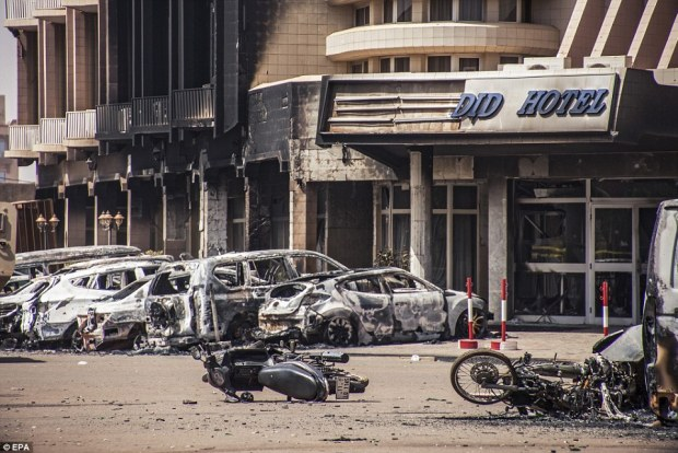 The charred remnants of several vehicles parked close to where the fighting took place inside the Splendid hotel