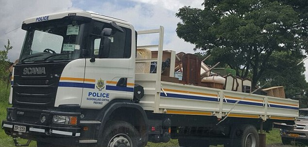 Dumped: Phillip and Anita Rankin were forced from their farm in Zimbabwe and their belongings were piled onto a police vehicle and driven away