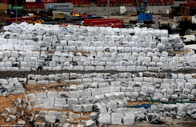 The waste has been packed together in white garbage bags and dumped on a piece of land at the harbour of the Lebanese capital, Beirut