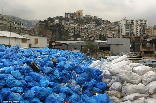 Hundreds of bags of wrapped rubbish is seen piled up high at a temporary dump in the town of Jdeideh, north east of Beirut, this week