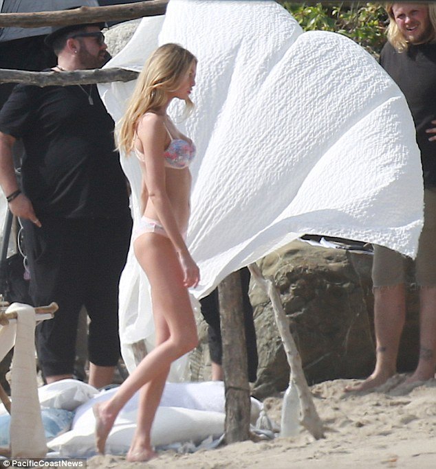 Lingerie babe: She wore her long blonde locks flowing loose for the beach shoot