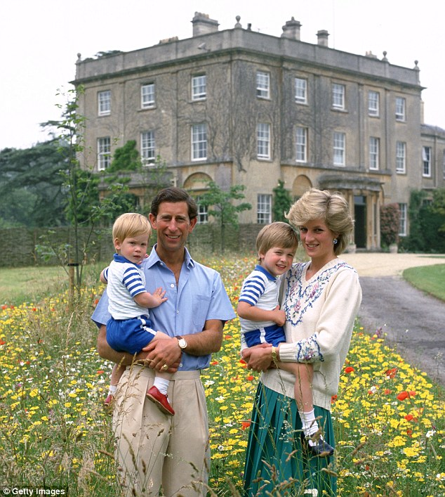 Prince Charles and Princess Diana pose with Princes William and Harry in the wild flower garden at Highgrove