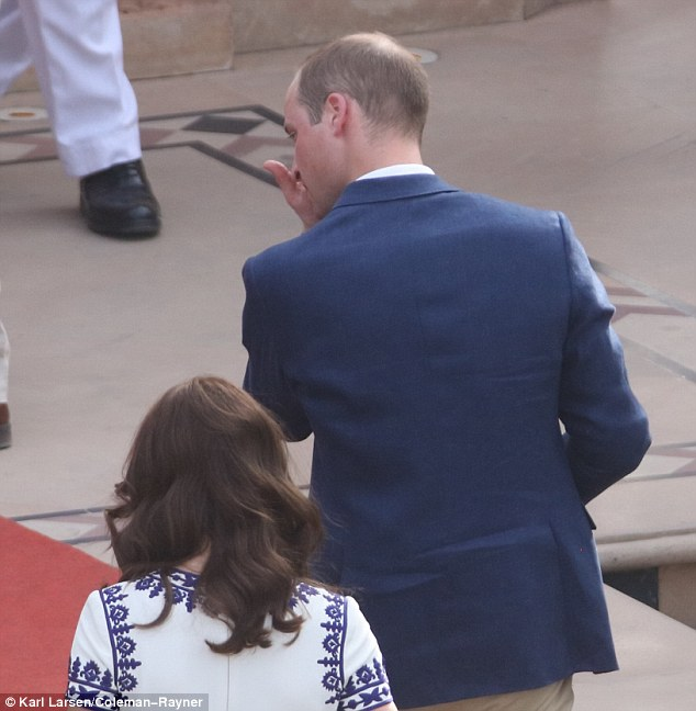 The Duke of Cambridge was seen wiping each of his eyes outside the mausoleum in India