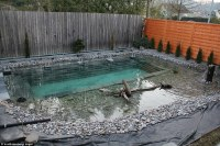 Swiss family spends $34,000 and one year building natural ...