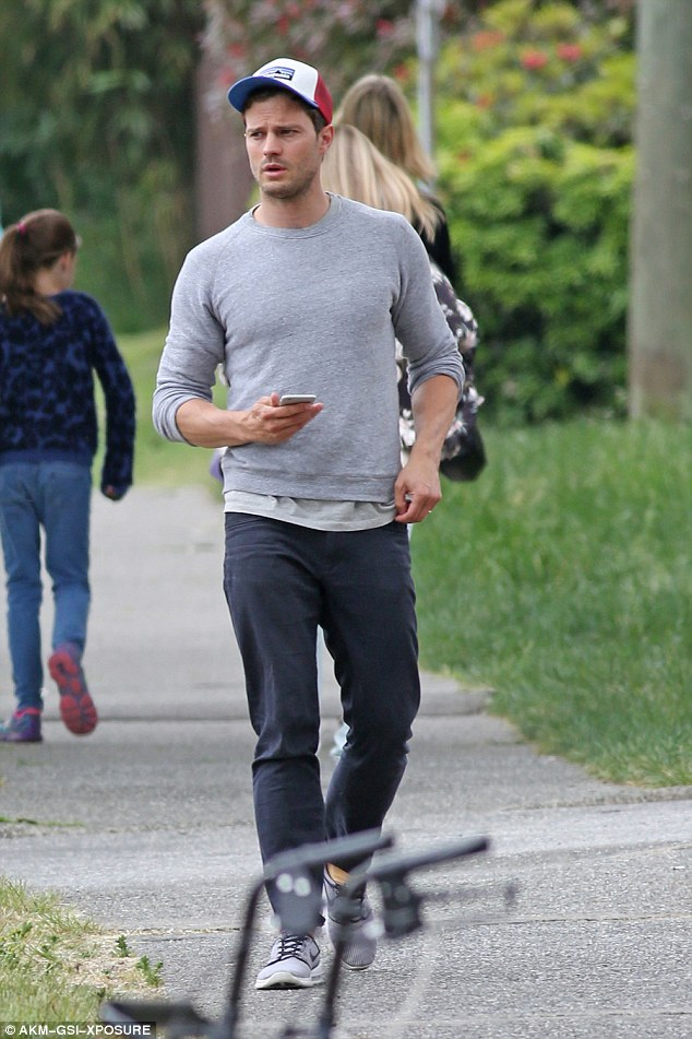jamie dornan and wife amelia are seen for the first with their newborn baby