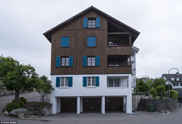 Payment: The town is full of alpine style chalets and modern glass fronted homes make it one of the most desirable - and expensive - places to live in Switzerland. The fine will be paid from the civic fund of £5million which is generated by local taxes