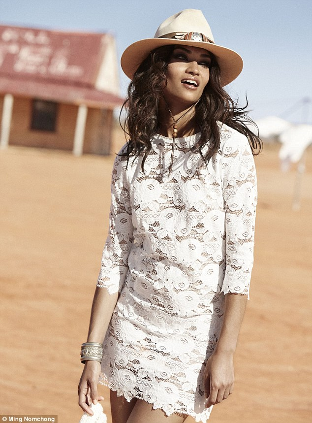 Striking: The sultry model opted for an embellished semi-sheer minidress in one image from the new photoshoot