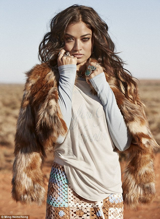 Getting hot under the collar: The model showcased a faux fur jacket during the desert shoot