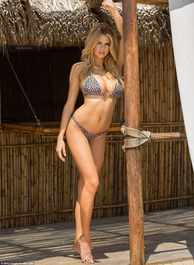 Caliente lady: Charlotte McKinney showed off her supermodel curves while on holiday at the ME Cabo resort in Cabo San Lucas, Mexico, on Saturday