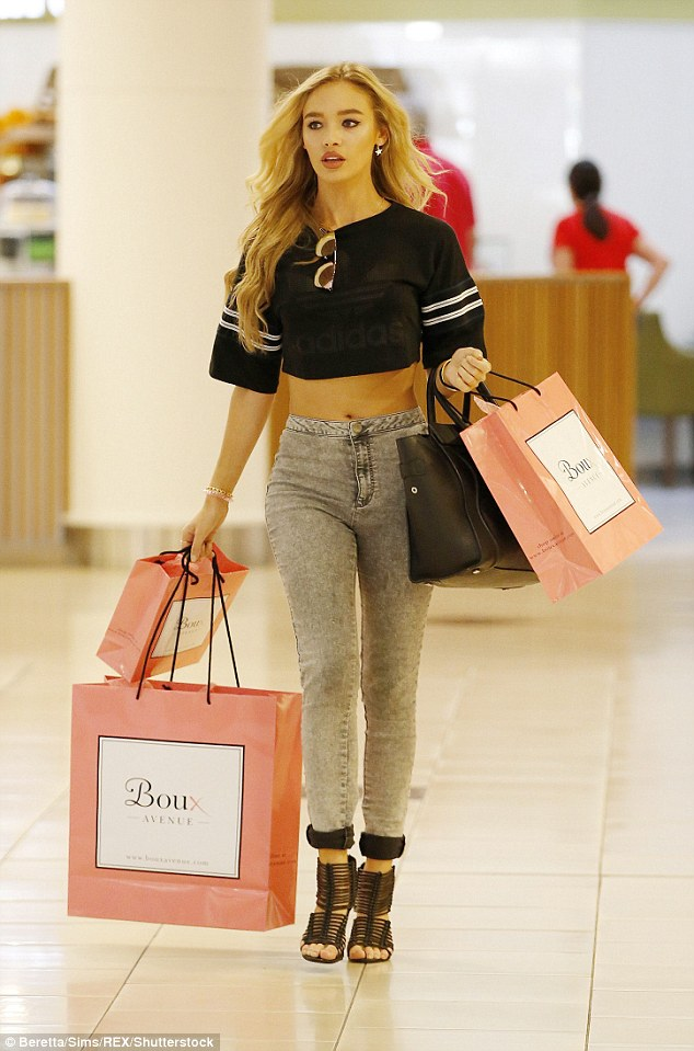 Shopping spree: British model Roxy Horner enjoyed some retail therapy on Friday when she treated herself to lots of new lingerie at the Boux Avenue store inside Essex's Lakeside Shopping Centre