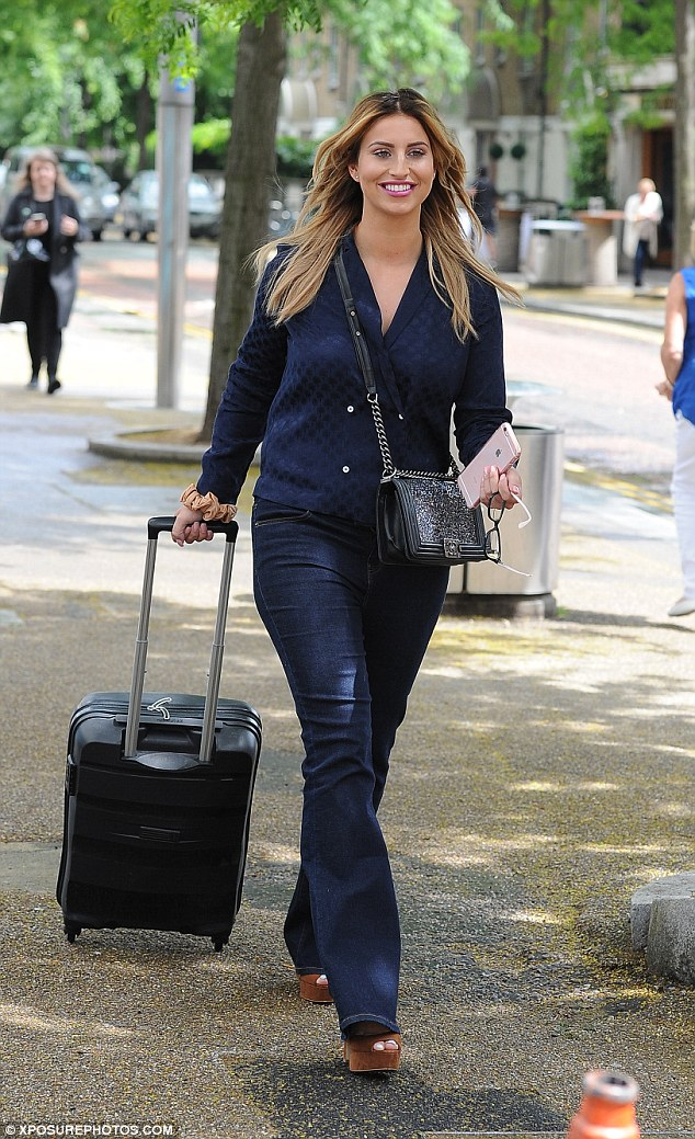 Jetting off: The previous day, the 25-year-old TV personality was seen leaving the ITV studios following her appearance on This Morning, suitcase in hand