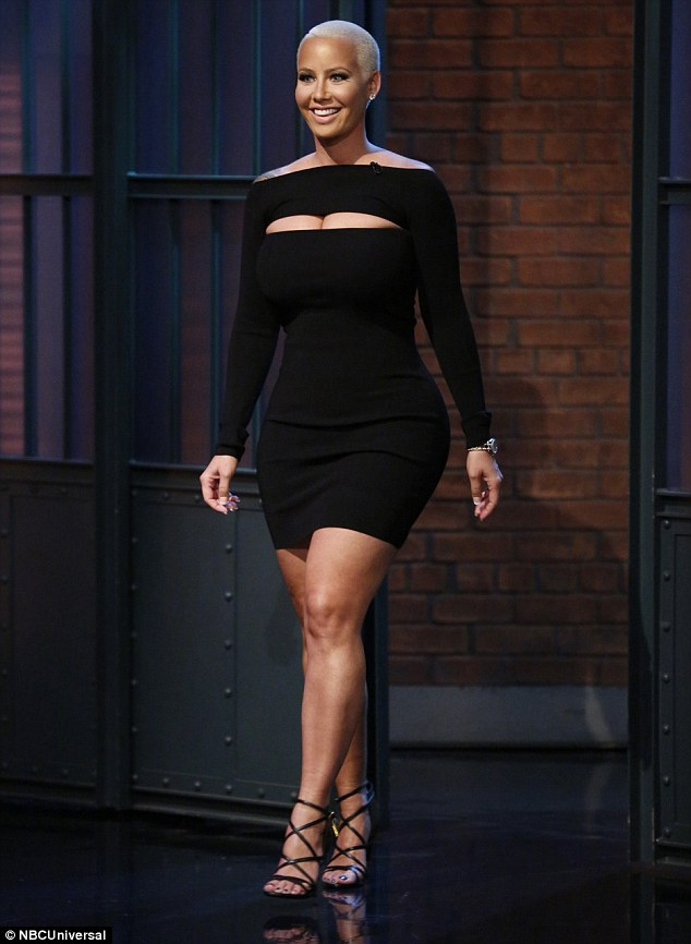 Little black dress: The model rocked a long-sleeved black dress with a front cutout
