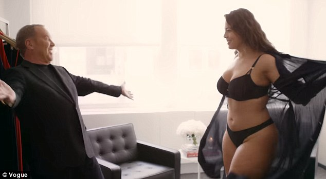 Getting a hand: Ashley's next stop in New York is a fitting with designer Michael Kors (left) who she strips off and has a little dance with before getting dressed