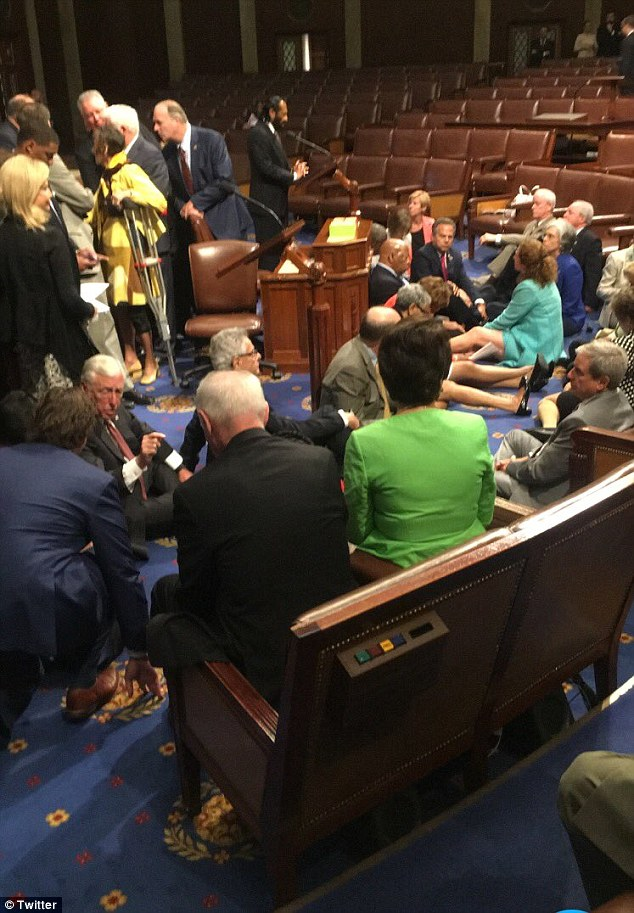 Top Democrats including Steny Hoyer (bottom left), the House Minority whip, joined John Lewis and other outspoken progressives in today's Capitol Hill sit-in