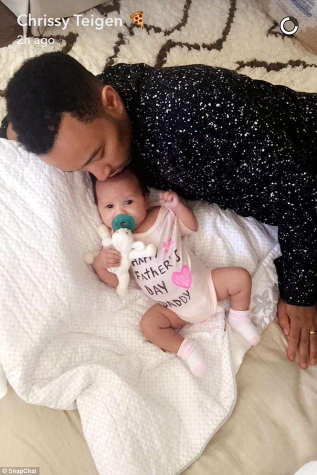 Daddy's little girl: Luna looked adorable in a pink onesie that donned the words 'Happy Father's Day Daddy'