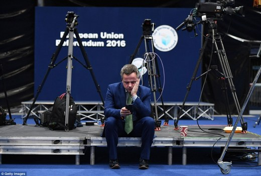 But the mood among 'remain' campaigners was glum. This pro-EU campaigner in Northern Ireland checks his mobile phone for early results which painted a grim picture for the overall result. Northern Ireland's Deputy First Minister later called for a referendum on Ulster joining the Republic of Ireland, which remains in the EU