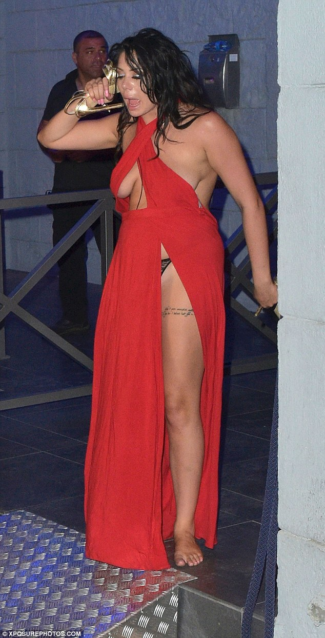 Oh dear: Chloe Ferry, 21, opted for a racy gown in a bold red, which boasted slashes along the entirety of her physique, while co-star Holly Hagan, 24, showed her entire chest in a sheer dress