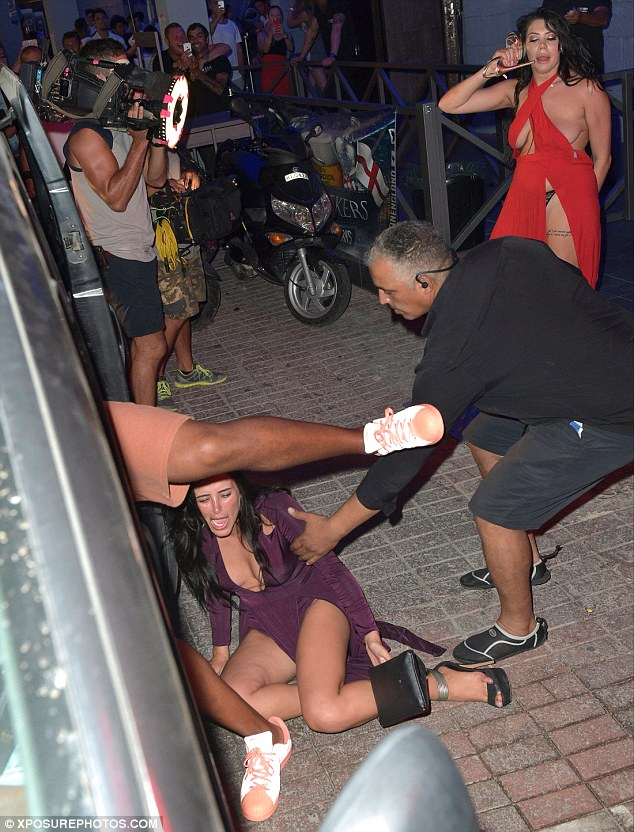Fall from grace:Marnie Simpson took a less than graceful tumble attempting to get into a cab after a night out with the Geordie Shore cast in Ayia Napa on Sunday.. as a barely dressed Chloe Ferry stood in the background speaking to her shoe