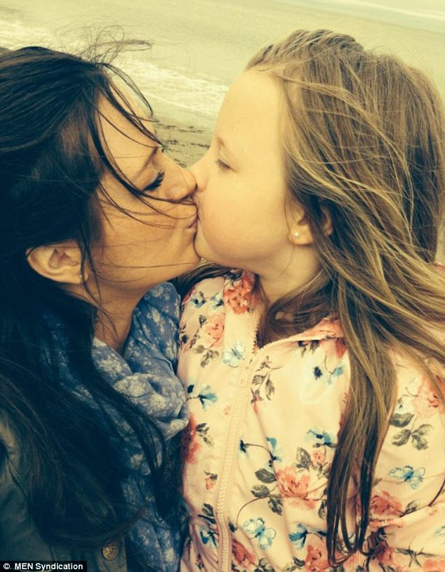 Parents have been sharing their own pictures of themselves kissing their children on the lips in the defence of the fashion designer. Pictured,Kathryn Evans and six-year-old Maisy