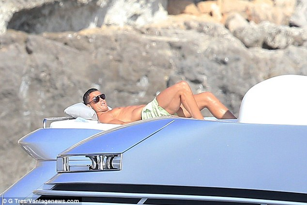 That's the life: The star's rippling six-pack was visible as he lay down