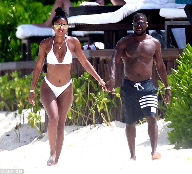 Lovebirds: Eniko showed off her fit figure in a white bikini as the couple strolled hand in hand