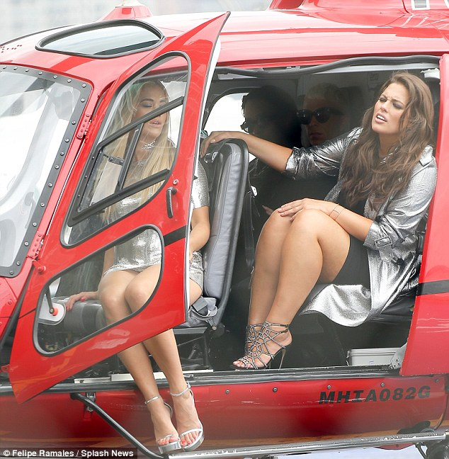 Trouble ahead: Rita struggled to exit the helicopter as elegantly as her new co-star