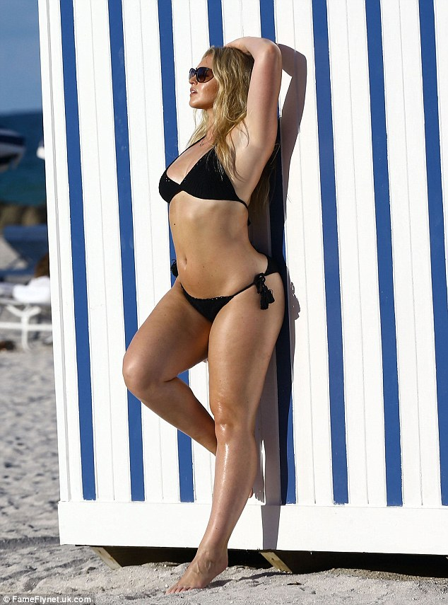 Back to black: The Worcester-born model soon changed into a black crochet bikini