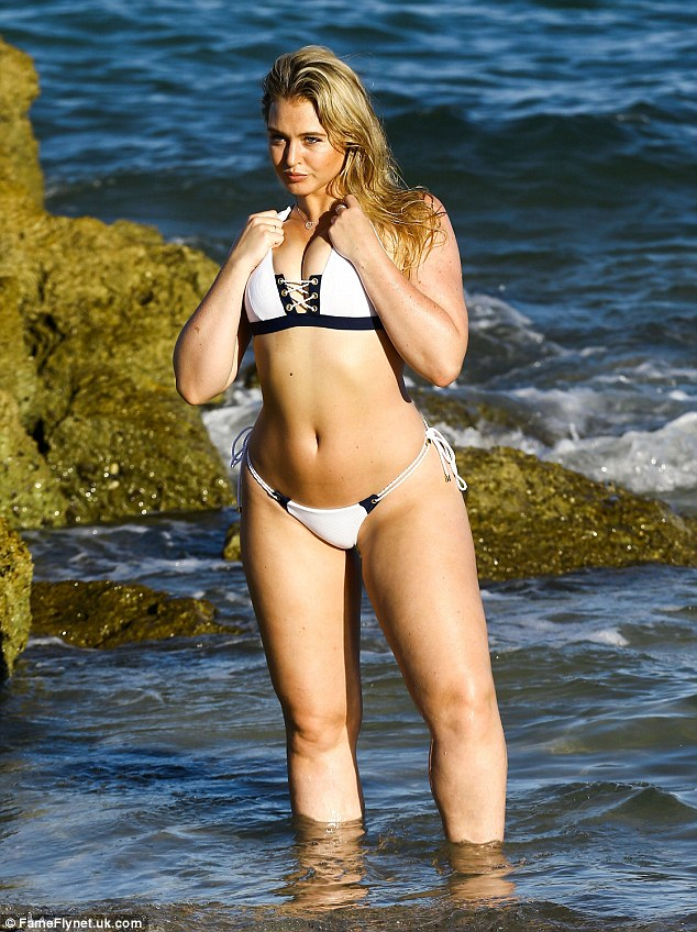 Monochrome madness: Her hot body has won her an army of followers