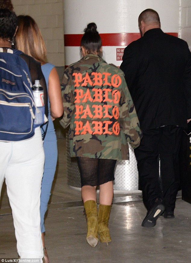 Representing: As Los Angeles is currently experiencing cool evenings, Kim was forced to add a jacket to her daring look picking a camouflage print coat from husband Kanye West's Pablo tour merchandise collection