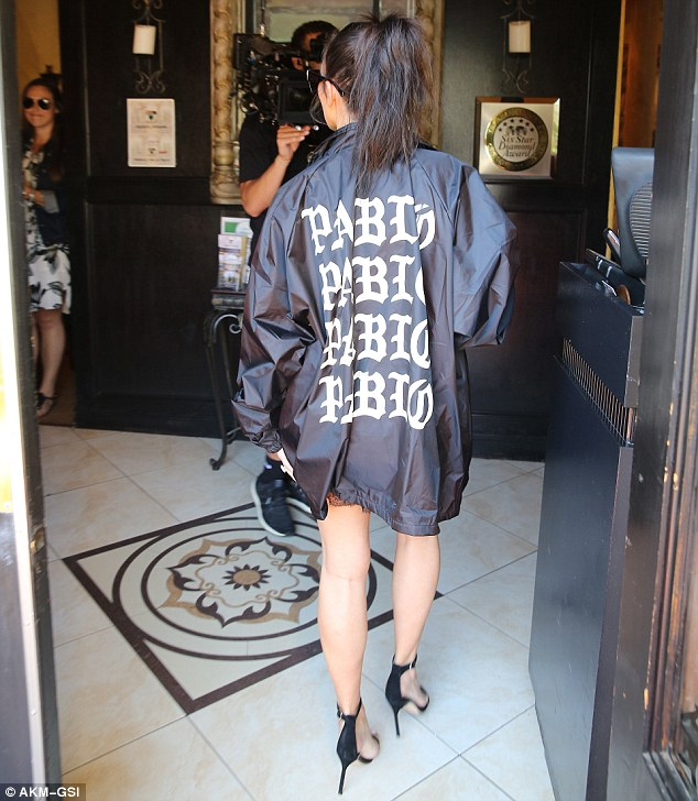 Nohting to see here: Kim gave nothing away from behind as she covered her posterior with the Pablo jacket. She wore her hair tied into a ponytail as cameras filmed her the the family's E! reality show