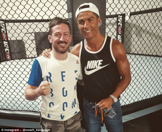 Ronaldo (right) also had a photo taken with McGregor's trainer and friend John Kavanagh at their Vegas gym