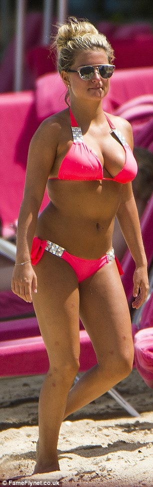 Zara looked sizzling hot in a vibrant halterneck bikini with diamante clips