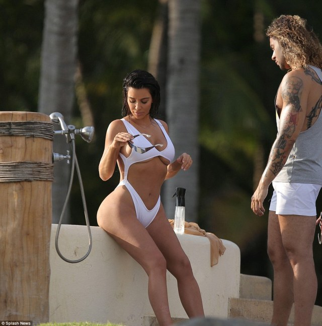 Peek a boo: Kim flashed an outrageous amount of underboob in her white one-piece