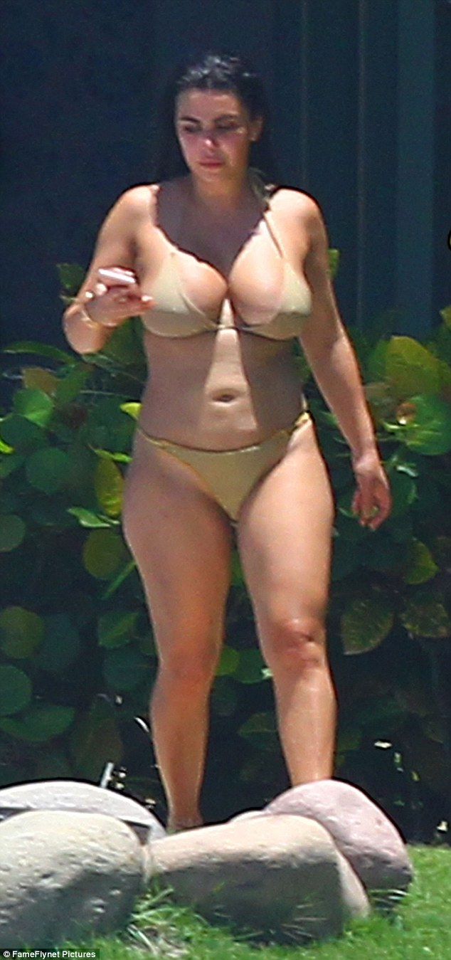 Lookalike: Kim Kardashian escaped the cameras for a day as one of her friends hung around the Punta Mita resort on Saturday sporting a similar bikini, fooling paparazzi