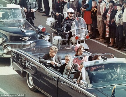 A former presidential security team member told director Oliver Stone that one of his team assassinated JFK (pictured, moments before his death)