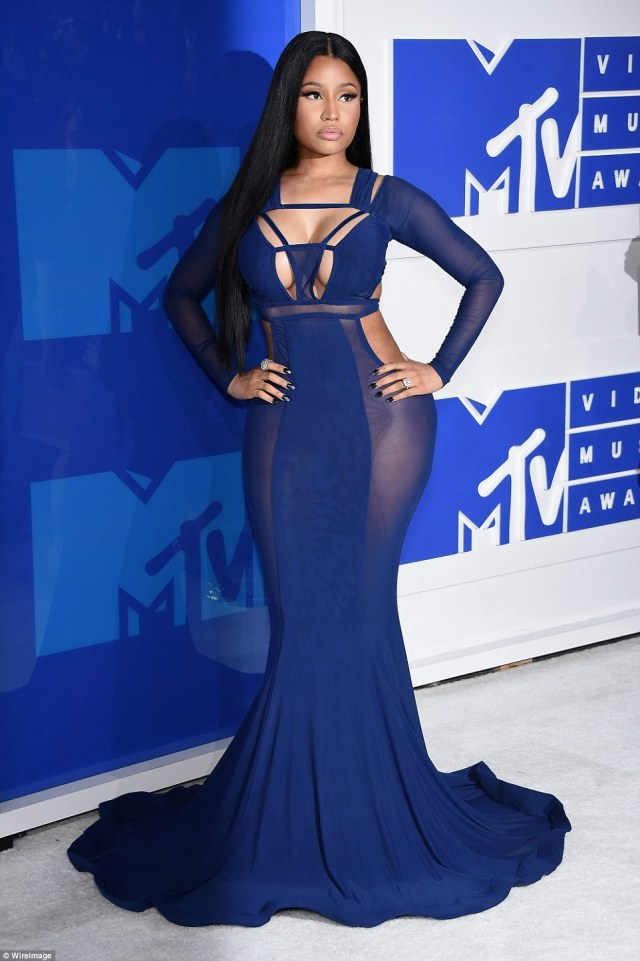 Strike a pose: Nicki Minaj put on a truly jaw-dropping show in a purple cut-out Bao Tranchi gown which accentuated every curve of her figure