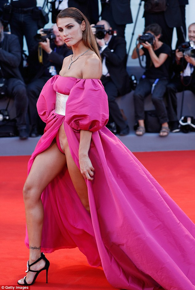 Brazilian model Dayane Mello left very little to the imagination in a slashed pink gown on the red carpet in Venice, despite the dress featuring a built-in bodysuit