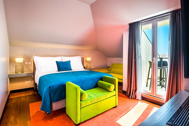 A room in Ronaldo's hotel is brightly coloured to represent his flamboyant personality