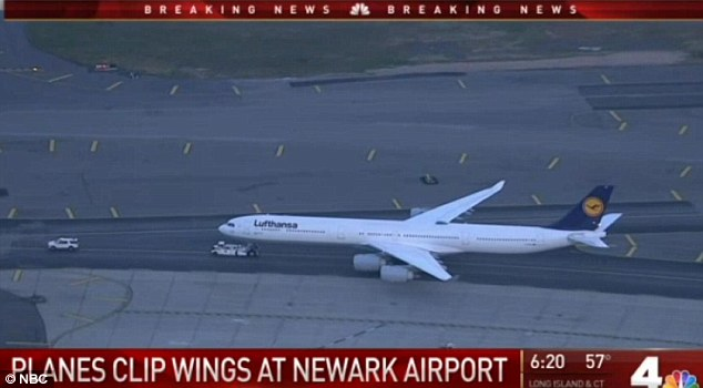 Lufthansa and United Airlines planes clip wings on Newark Airport