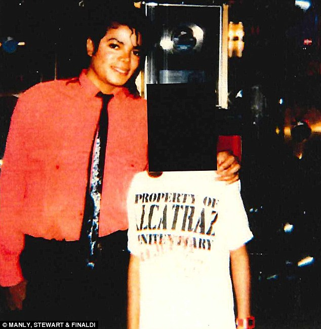 A new Michael Jackson sex abuse accuser (pictured with him as a child in the 1980s)  has come forward to claim she was abused by the singer when she was just 12 years old - and then paid $900,000 to keep quiet